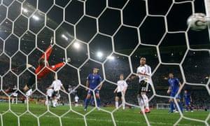 German goalkeeper Jens Lehmann dives in vain as Fabio Grosso's shot flies past him.