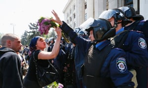 A woman argues with Ukrainian Interior Ministry security forces members during a rally outside a trade union building in Odessa, May 3, 2014.