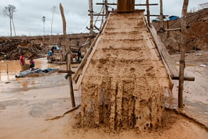 Illegal gold mining: Water streams over carpets that filter the earth and water