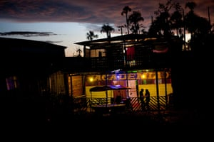 Illegal gold mining: A couple talks outside a night club