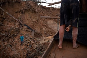 Illegal gold mining: A miner walks amid the destruction of the jungle