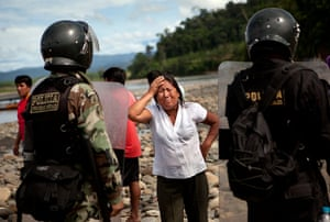 Illegal gold mining: A woman cries in front of police