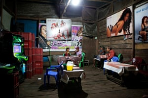 Illegal gold mining: People gather in a bar at an illegal gold mine