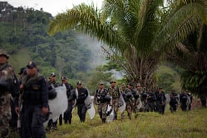 Illegal gold mining: Police and soldiers walk to helicopters