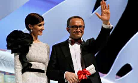 Leviathan director Andrey Zvyagintsev collects his prize from Paz Vega at Cannes on 24 May