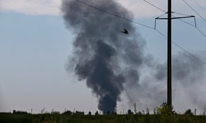 Black smoke rises from where Ukrainian army helicopter landed near Slavyansk after being shot down