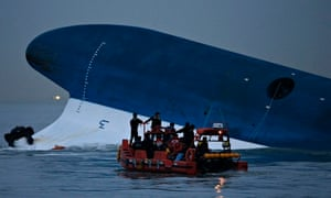 South Korean maritime police search the bow of the Sewol