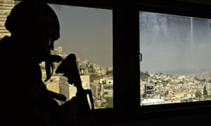 An Israeli soldier at a command post overlooking Nablus