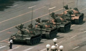 Symbol of defiance … a man blocks a line of tanks in Tiananmen square.