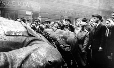 Hungarian protesters gather around a fallen statue of Josef Stalin in Budapest in October 1956.