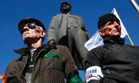 A pro Russian rally in Donetsk, eastern Ukraine, with a statue of Lenin in the background.