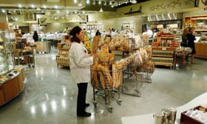 A clerk in the bread department of a Whole Foods