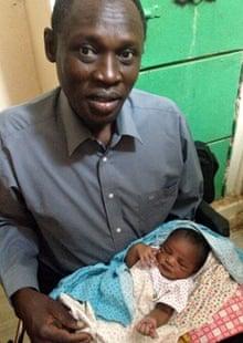 Daniel Wani with his daughter Maya, born at the women's prison in Omdurman, Sudan