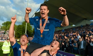 Leinster's Brian O'Driscoll celebrates with team-mates Ian Madigan, left, and Cian Healy