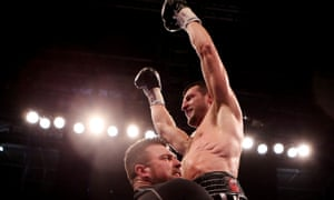 Carl Froch celebrates defending his IBF and WBA World Super Middleweight titles.