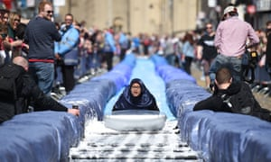 A participant takes part in the Bristol Park and Slide project, an interactive temporary  installation by artist Luke Jerram set up in Park Street