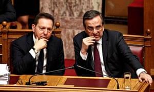 Greek finance minister Yannis Stournaris in parliament with prime minister Antonis Samaras