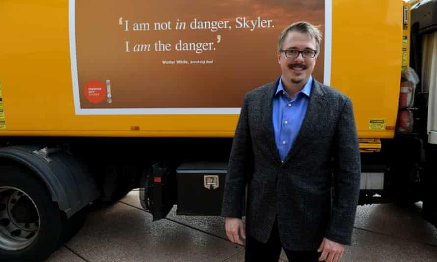 Gil.igan poses with the Sydney garbage van emblazoned with his words.