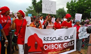 Protestors march to force action over the abducted Nigerian schoolgirls of Chibok on 30 April 2014