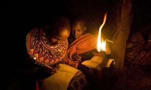 Children studying at night using a flame on a stick. How could regular affordable energy change educ
