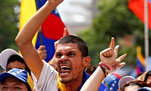 Anti-government protesters shout during a demonstration in Caracas