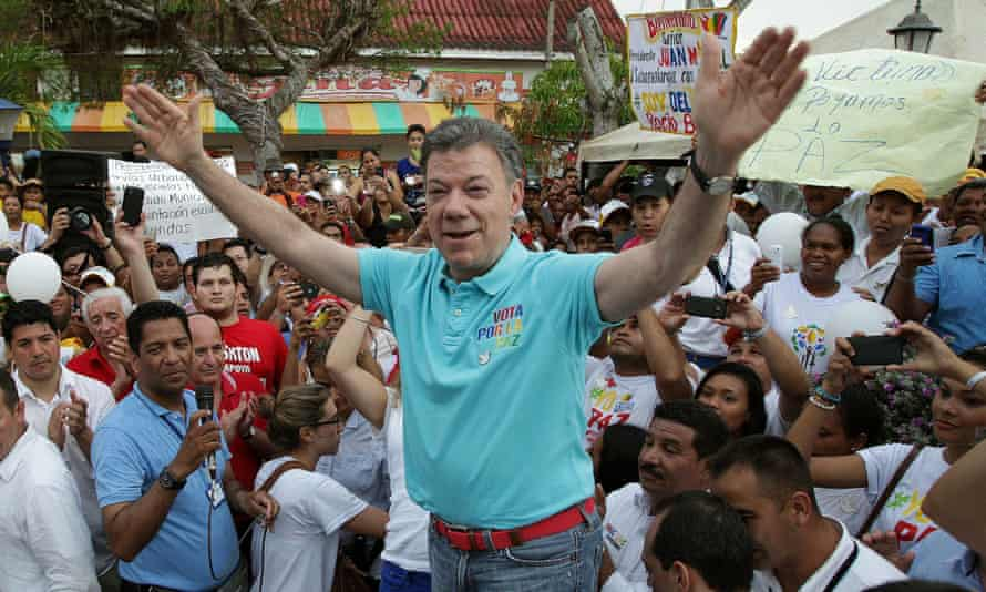 Juan Manuel Santos, shown campaigning for re-election, said JJ Rendon had made a 'gallant' gesture by resigning