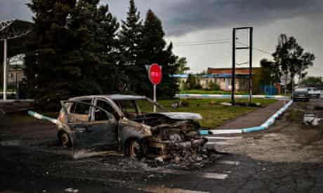 A burnt-out car parked on a road near Semyonovka village, near Slavyansk