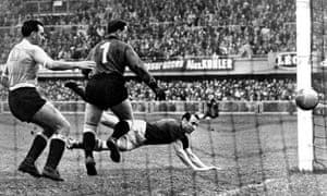 Nandor Hidegkuti scores against Uruguay in the semi-finals.