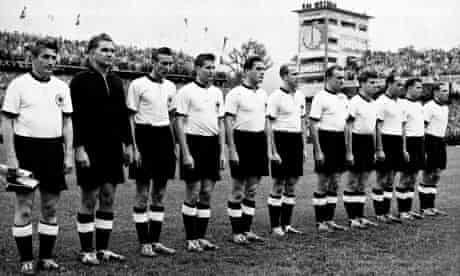 West Germany players line up before the start of the final in Bern.
