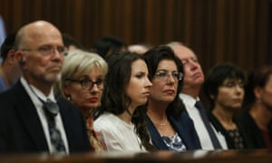 Family members of Oscar Pistorius listen to a witness testifying during his murder trial in the high court in Pretoria on Tuesday.