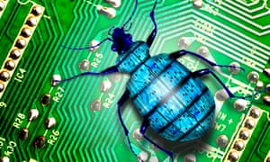 Blue Creepy Crawly Bug Crawls Over Green Electronic Circuit