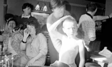 A detail from the photograph of a young boy in a crowded bar in No Pain Whatsoever.