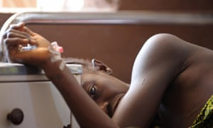 A woman waits for treatment in the maternity ward at Makeni government hospital in Sierra Leone, a country with one of the highest maternal death rates in the world.