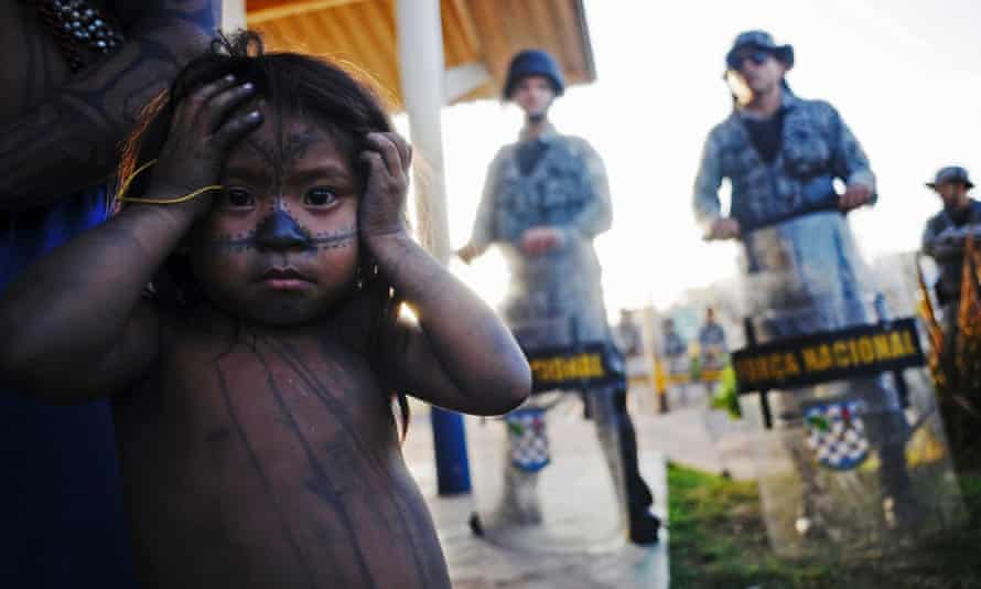 A Munduruku girl at the Belo Monte hydroelectric dam - just one of 256 planned dams for Brazil, and one of 412 across the entire Amazon basin and its headwaters.