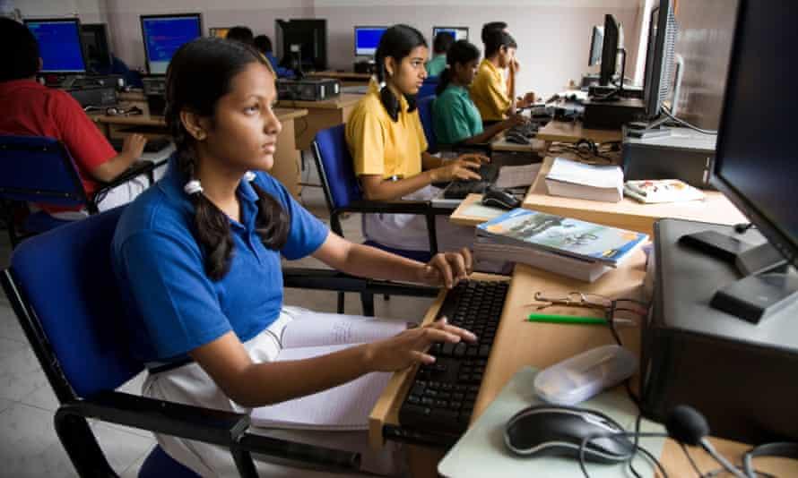 tudents in a computer studies class at school in Hazira, near Surat. Gujarat. India.