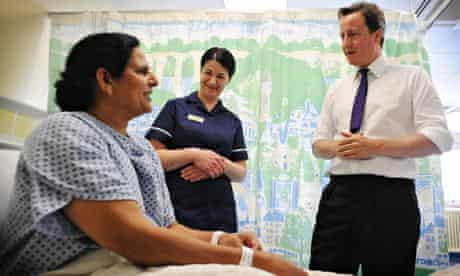 David Cameron meeting a patient in a hospital