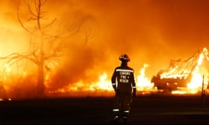 the new climate change deniers argument global warming is good  an edmond firefighter looks at a fire raging in a mobile home park in oklahoma on