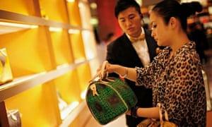 A woman shops in a Louis Vuitton store