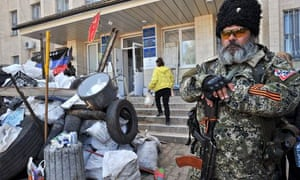 A pro-Russia militant guards a barricade outside Kramatorsk city hall, eastern Ukraine