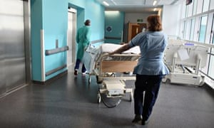 A patient being taken to an operating theatre in a hospital