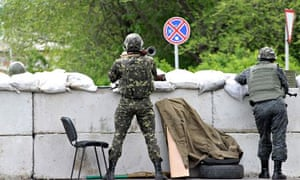 Ukrainian soldiers guarding a checkpoint