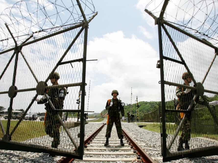 South Korean soldiers open the gate for a North Korean train to pass near the demilitarized zone (DMZ).