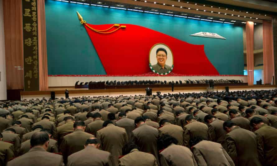 North Korean military officers bow at an image of late North Korean leader Kim Jong-il during a national meeting of top party and military officials in 2012.