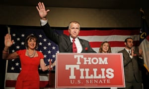Thom Tillis waves to supporters as he celebrates with his wife Susan, left, son Ryan Tillis and daughter Lindsay after winning the North Carolina GOP Senate primary