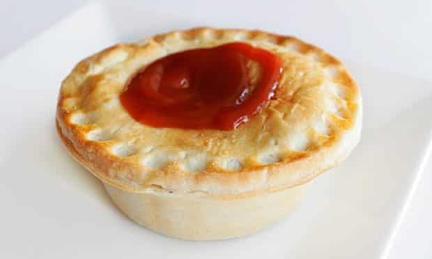 A meat pie and sauce.
