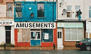 88902eb9ee4 A man fixes an aerial above boarded-up shops in Middlesbrough. Photograph:  Ben Quinton for the Guardian