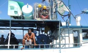 Juan Carlos Barrantes on his fishing boat during checks by the Cocos Island patrol, Costa Rica