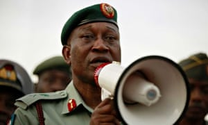 Nigeria's top military spokesman, speaks to people at a demonstration