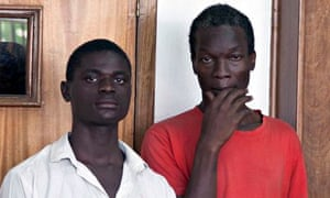 Mukasa Jackson, left, and Mukisa Kim, right, in court in Uganda charged with engaging in gay sex