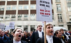 Barristers in wigs and robes protest at the Department for Justice over cuts to the legal aid budget